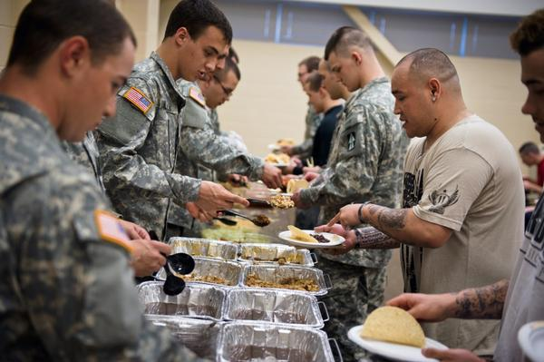 Barillaro (second from right) eats with soldiers and recruits at the National Guard Armory in Evansville, Ind., where he is performing later the same day.