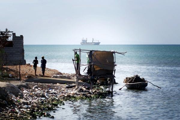 A makeshift latrine hangs over Port-au-Prince Bay at the edge of Cite de Dieu.