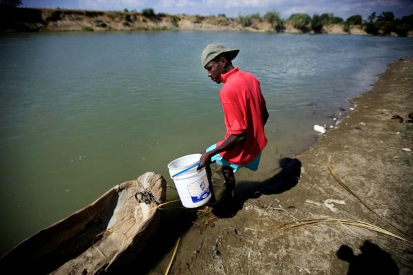 Most people in this rural part of Haiti, near Saint-Marc, get their water from the Artibonite River. Though the river is known to be contaminated with cholera, few can afford chlorine tablets to purify the water.