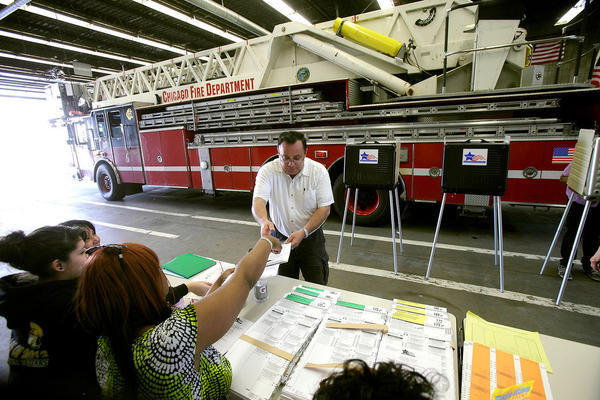 A man picks up a ballot at a Chicago fire station. The GOP's incremental delegate race has put an unexpected spotlight on the Illinois primary.