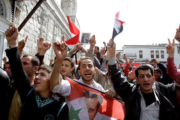 Syrians chant slogans in support of President Bashar Assad during a demonstration in the capital, Damascus, on March 25.