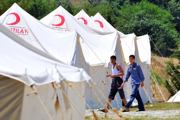 Refugees take shelter at a camp in Turkey's southern Yayladagi district on June 8.