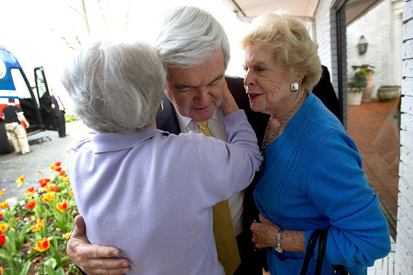 Newt Gingrich is hugged by Helen Smalley (right) and Betty Weeks after speaking to the Vestavia Hills Chamber of Commerce in Birmingham, Ala.