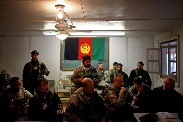 U.S. and Afghan security officers meet with civilian Afghan role-players.