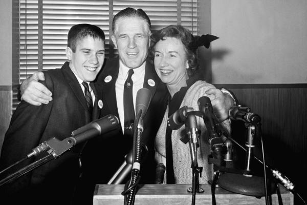 Flanked by his wife, Lenore, and son Mitt, George Romney announces his run for governor of Michigan at a news conference in 1962.