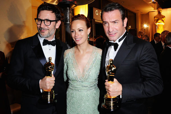 "Director Michel Hazanavicius (from left), who won Best Director for the black-and-white silent film ""The Artist,"" poses with stars of the film Berenice Bejo and Jean Dujardin, who won Best Actor."