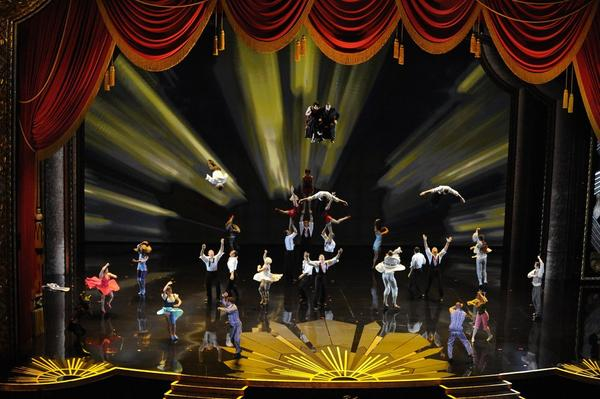 In an airborne homage to movie-making, Cirque du Soleil performers flew and flipped for the audience assembled at the Hollywood & Highland Center.