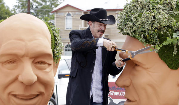 Kinky Friedman trims the ivy growing as hair on a 6-foot bust of Gov. Rick Perry. In 2006, Friedman came in fourth in his bid to be governor of Texas, drawing in part on his fame as a country musician. He has also written several mystery novels.