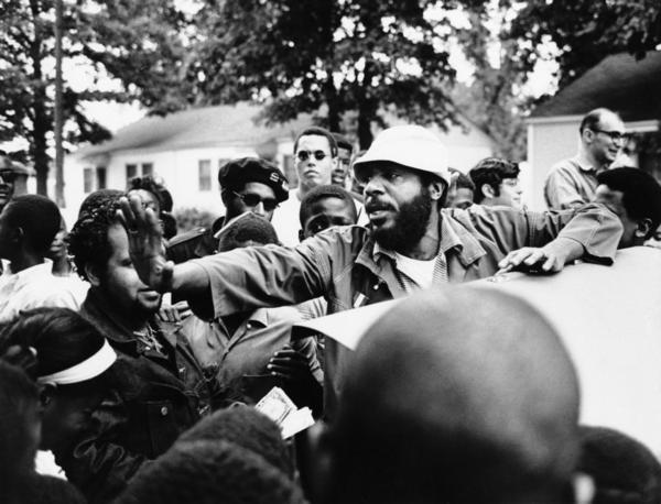 Dick Gregory, a social and political comedian, ran for president on the Peace and Freedom Party ticket. Here, he clears his way before speaking in Norfolk's Liberty Park, on Oct. 18, 1968.