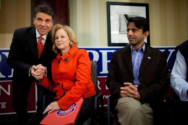 Rick Perry and his wife, Anita, before speaking to voters in West Des Moines. At right is Louisiana Gov. Bobby Jindal.