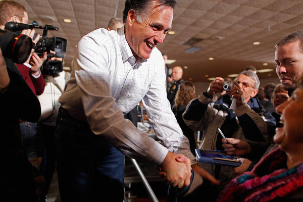 Mitt Romney greets supporters and gives autographs during a rally at the Mississippi Valley Fairgrounds Monday in Davenport, Iowa.
