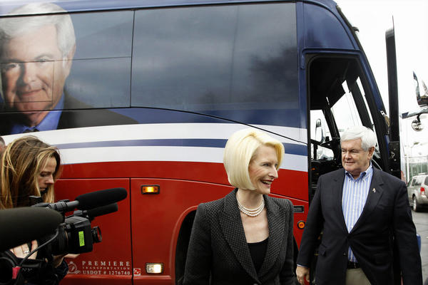 Former House Speaker Newt Gingrich and his wife, Callista, walk off his campaign bus during a Dec. 27 stop at the Dubuque Golf and Country Club in Dubuque, Iowa.