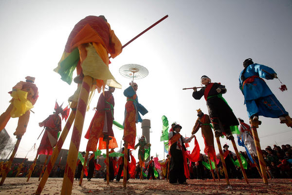 Villagers stilt walk during Shehuo celebrations in China's Qinghai Province in 2009.
