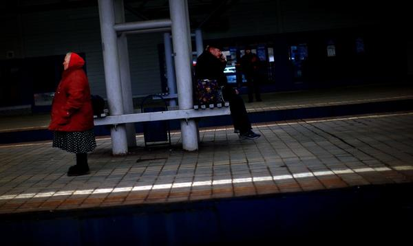 Passengers wait on a train platform at Yaroslavsky Rail Station in Moscow.