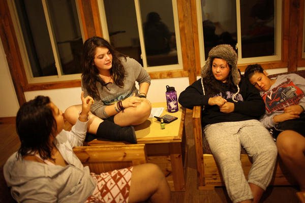 Bethany Gomez (from left), Ana Pierdant, Rachel Fujiyoshi and Jessica Wiegel swap stories and paint fingernails in their dorm before lights out.