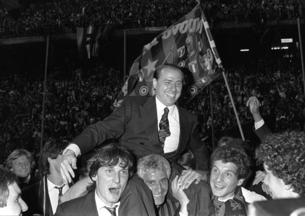 Berlusconi, then and still owner of football club AC Milan, is carried by Milan players after the team won the 1988 Italian soccer championship.