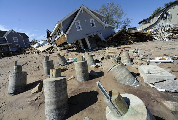 Beachfront homes destroyed by the storm are seen in East Haven, Conn., on Monday.