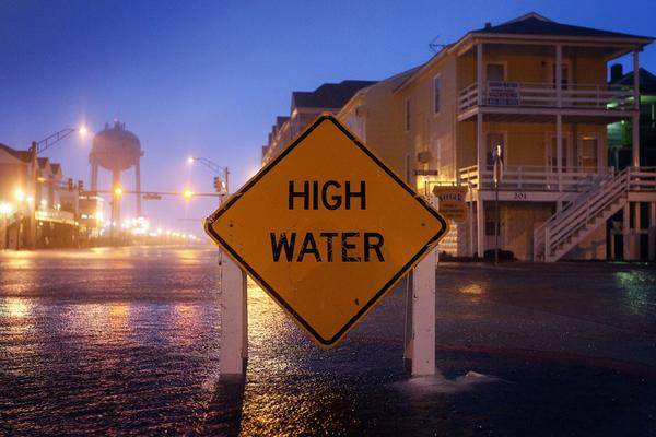 A sign stays just above the water in Ocean City, Md., on Saturday.
