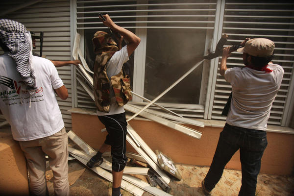 Rebels break into a living room at Gadhafi's compound.