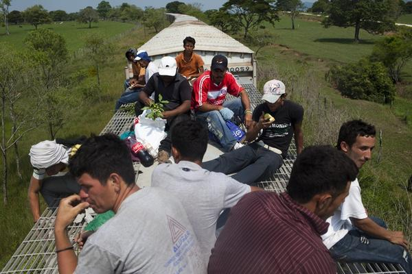 Once they climb atop a train, migrants face a dangerous ride, as it gets brutally hot during the day and cold at night.
