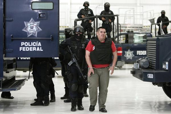 """<b>Captured June 22, 2011:</b> Jose de Jesus Mendez Varga, aka El Chango, or """"The Monkey,"""" is paraded before the media in Mexico City a day after he was seized by Mexican federal police in the central state of Aguascalientes. The alleged leader of the La Familia cartel is accused of moving tons of cocaine, meth and marijuana to the U.S."""