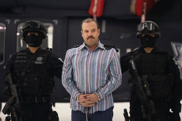 "<b>Captured Nov. 23, 2010:</b> Carlos Montemayor, aka El Charro, or ""The Cowboy,"" the alleged leader of the Beltran Leyva gang, appears with police officers a day after his arrest in Mexico City."