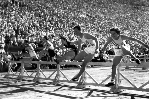 "Mildred ""Babe"" Didrikson, one of the most versatile athletes of all time, first received attention as a star in basketball and track and field. Here, Didrikson (second from right) pulls ahead of teammate Evelyne Hall (far right) to win the women's 80-meter hurdles at the 1932 Summer Olympics in Los Angeles."
