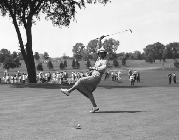 Zaharias urges the ball into the cup on the 18th green at the Women's All-American Golf Tournament on Aug. 4, 1950.