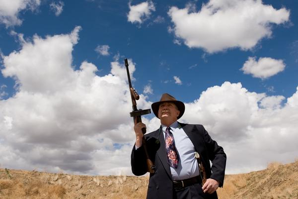 """""""G Man"""" Steve Fowler, a real-life police detective and """"good guy"""" in both Zoot Shooters capers and cowboy action shooting competitions, poses with his Tommy gun."""