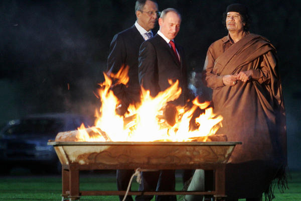2008: Russia's Vladimir Putin (center) meets with Gadhafi (right) in Tripoli. Putin spent two days in Libya on an official visit to rebuild Russian-Libyan relations.