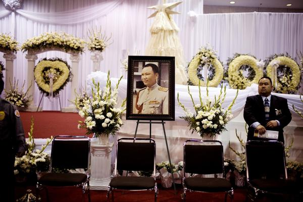 A portrait of Vang sits amidst funeral wreaths at the Fresno Convention Center.