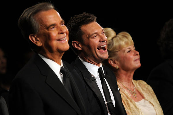 A debilitating stroke in 2004 forced Clark to cut back on public appearances. Here, he and his third wife, Kari Wigton, hang out at the 2010 Daytime Emmy Awards with Ryan Seacrest, who'd become his co-host on <i>New Year's Rockin' Eve</i>.