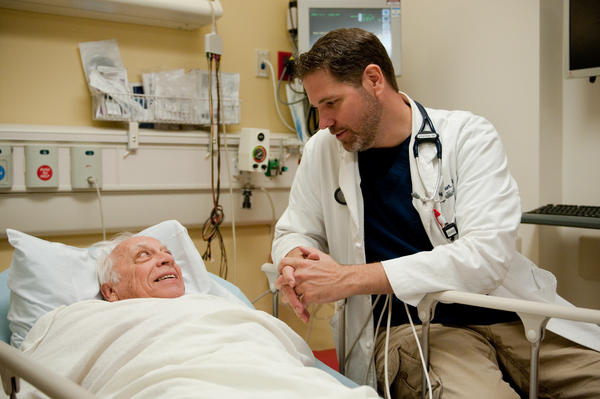 Patient Bob Berquist with Gregory Wagner, a doctor in the emergency department. Berquist, who volunteers at Fauquier Hospital, was admitted for low blood sugar when another nurse noticed he seemed dizzy.