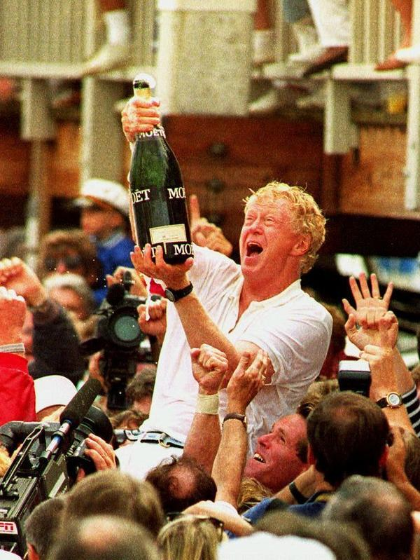 Bill Koch (center) celebrates his team's 1992 America's Cup win. Koch, the brother of billionaire GOP donors Charles and David, has given $2 million to the superPAC backing Mitt Romney.