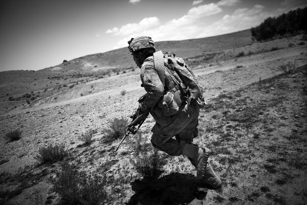 Pfc. John Ewing of Denver runs through incoming insurgent rounds during the battle in Babaker.