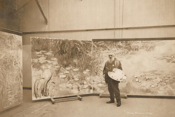 Monet works on one of his many water lily painting<em></em>s in his studio at Giverny in 1920.