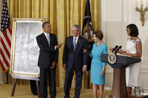 President Obama and his wife Michelle host a rare get-together with their White House predecessors on Thursday, as former President George W. Bush and his wife Laura had their official portraits unveiled.