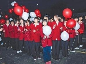 Students from China celebrate the dedication of the Taylor International School and dorm, where they live while attending Lake Shore High School in St. Clair, Mich.