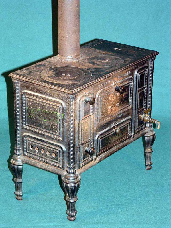 """In the late 19th and early 20th century, toy stoves differed from real stoves only in size. Made of steel or cast iron, they were heated with wood or pellets of solid fuel. """"Cooking can be done upon this range,"""" proclaimed one ad from 1892. The stove pictured here dates from the 1920s."""