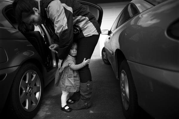 Crystal Turner, a Marine veteran now attending classes at Sierra College, helps her 1 1/2-year-old daughter, Marley Rose, out of a car. Turner is balancing classes and working at the vets center on campus with being a full-time mother.