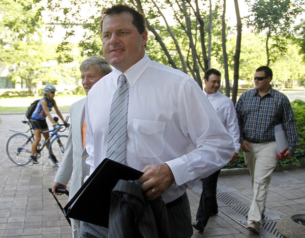 Former Major League Baseball pitcher Roger Clemens, accompanied by his attorney Rusty Hardin, left, arrives at federal court in Washington on Monday.