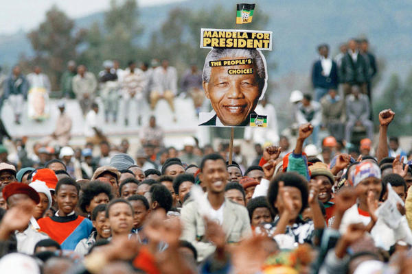 Mandela supporters cheer during an election rally in Thaba Nchu, South Africa, on April 21, 1994.