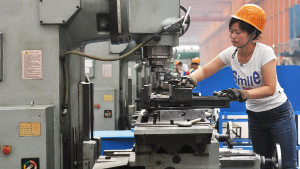 A Chinese worker operates a machine at a factory in Binzhou in northeast China's Shandong province. China's exports and imports shot up in May year-on-year, the customs agency said on June 10, defying expectations amid a slowdown in the world's second largest economy.