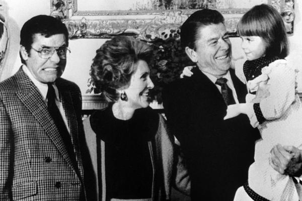 Lewis makes a face in 1981 as President Ronald Reagan and his wife, Nancy, receive Christi Bartlett, a child with muscular dystrophy.