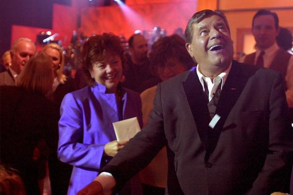 Lewis and his wife, Sam, look toward the audience after closing his Muscular Dystrophy Telethon in 2000. He helped raise more than $50 million in under 22 hours.