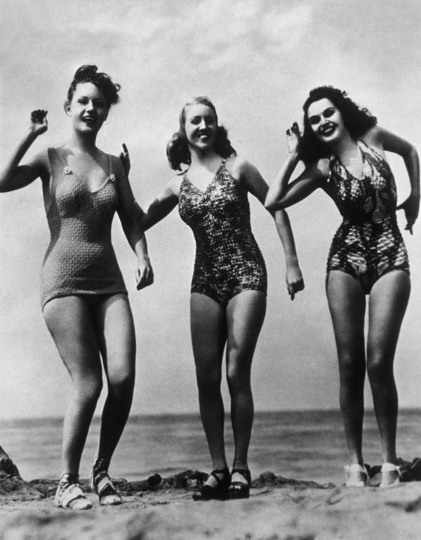 A trio at the beach, clad in state-of-the-art (in 1948) suits.