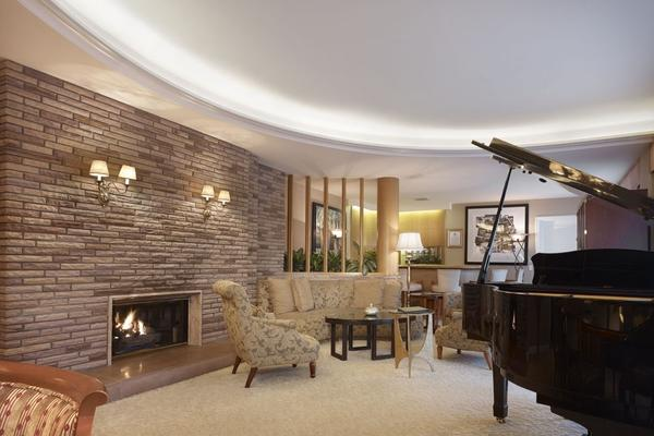Another view of the Historic Paul Williams Suite. Originally designed in the late 1940s, the suite was moved to the second floor during a renovation in the 1990s, and re-created just as Williams designed it. It contains the same use of stone, curved walls and marble that are found in many of his permanent homes.