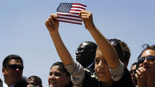 Audience members listen to President Obama speak about immigration reform at Chamizal National Memorial Park in El Paso, Texas, on May 10, 2011. Both Obama and Republican Mitt Romney see garnering Latino votes as critical to winning the fall election.