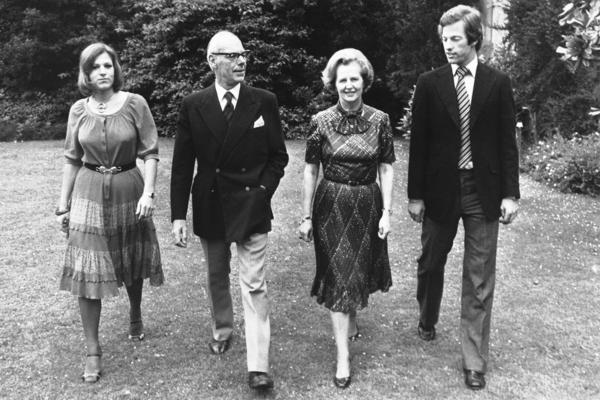 Thatcher strolls through the grounds of Scotney Castle in Kent, England, where she was a tenant of a National Trust flat. With her in this March 1979 photograph are her husband, Denis, and their twins, Mark and Carol.