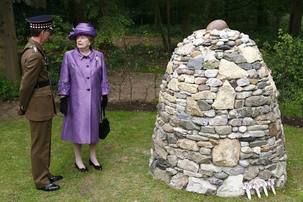 Thatcher stands by a memorial cairn built from 255 stones (one stone for each British serviceman killed) that were brought from the Falkland Islands as part of commemorations of the 25th anniversary of the end of the conflict, at the Falkland Islands Memorial Chapel in Pangbourne, England, June 14, 2007.